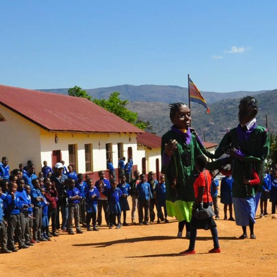 Giant puppets in Swaziland playing a new awareness show about early pregnancies